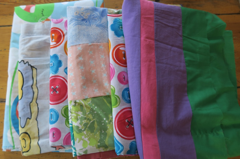 These are some European singles that are ready to sandwich. Each of these will be reversible since I'm using one big large piece of fabric I purchased here in Poland.