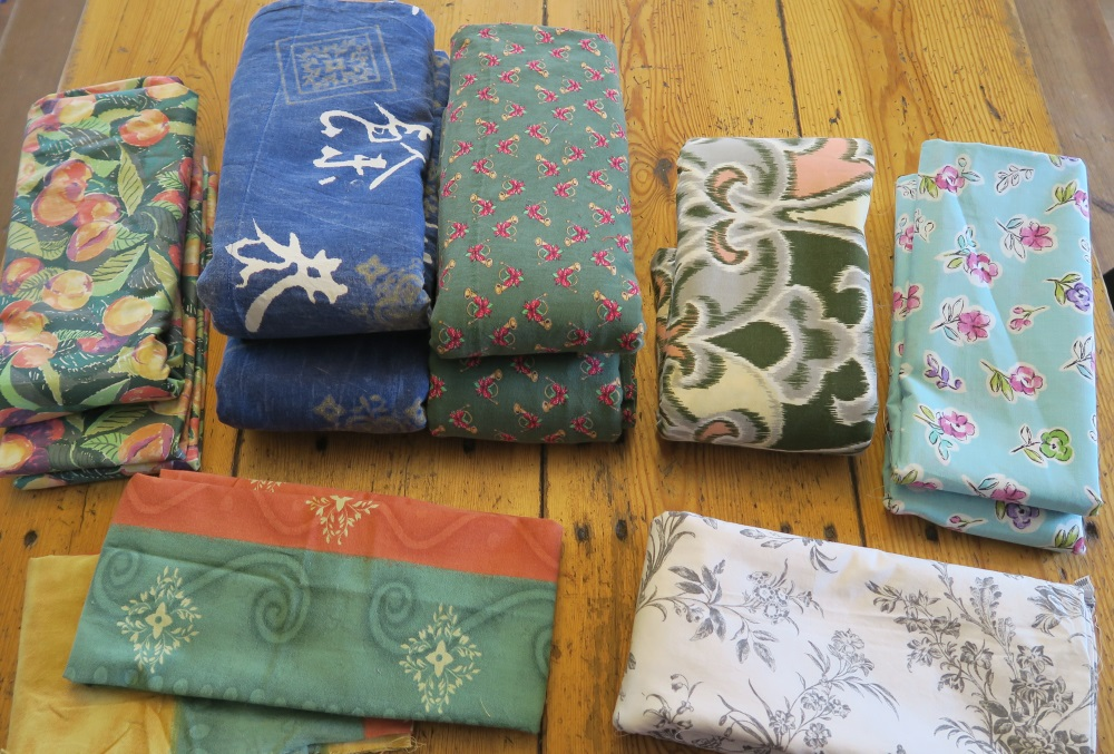 Prints - and I've made that pile of green fruit on the back row into a large backing already - hope to sandwich that quilt tomorrow.