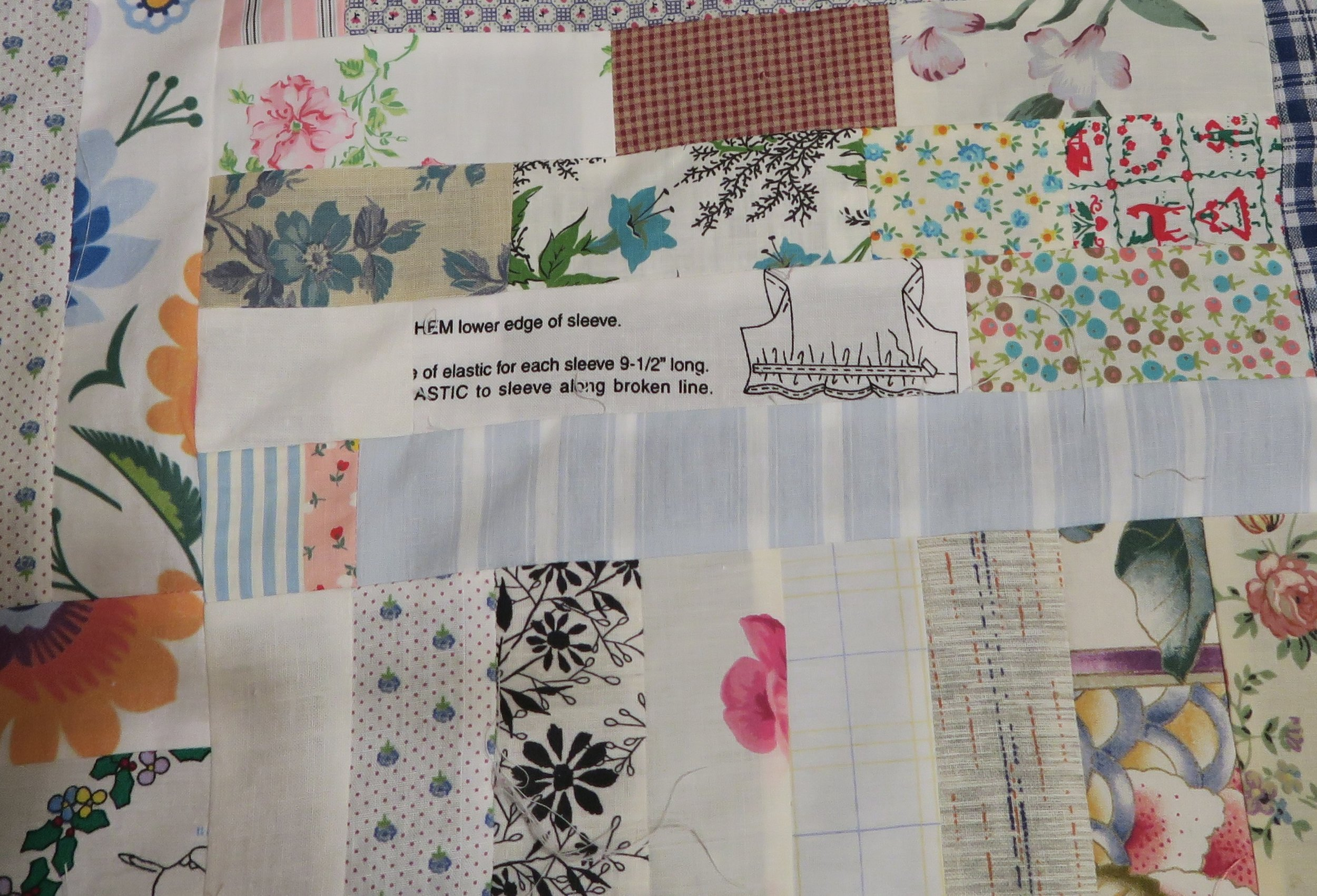 These are the kinds of things I like to put in this kind of quilt.  These were leftover from various low volume things I had made.  I tried to stick to pretty much white or off white backgrounds - and keep the print to minimum, though at times I didn't do that very well.