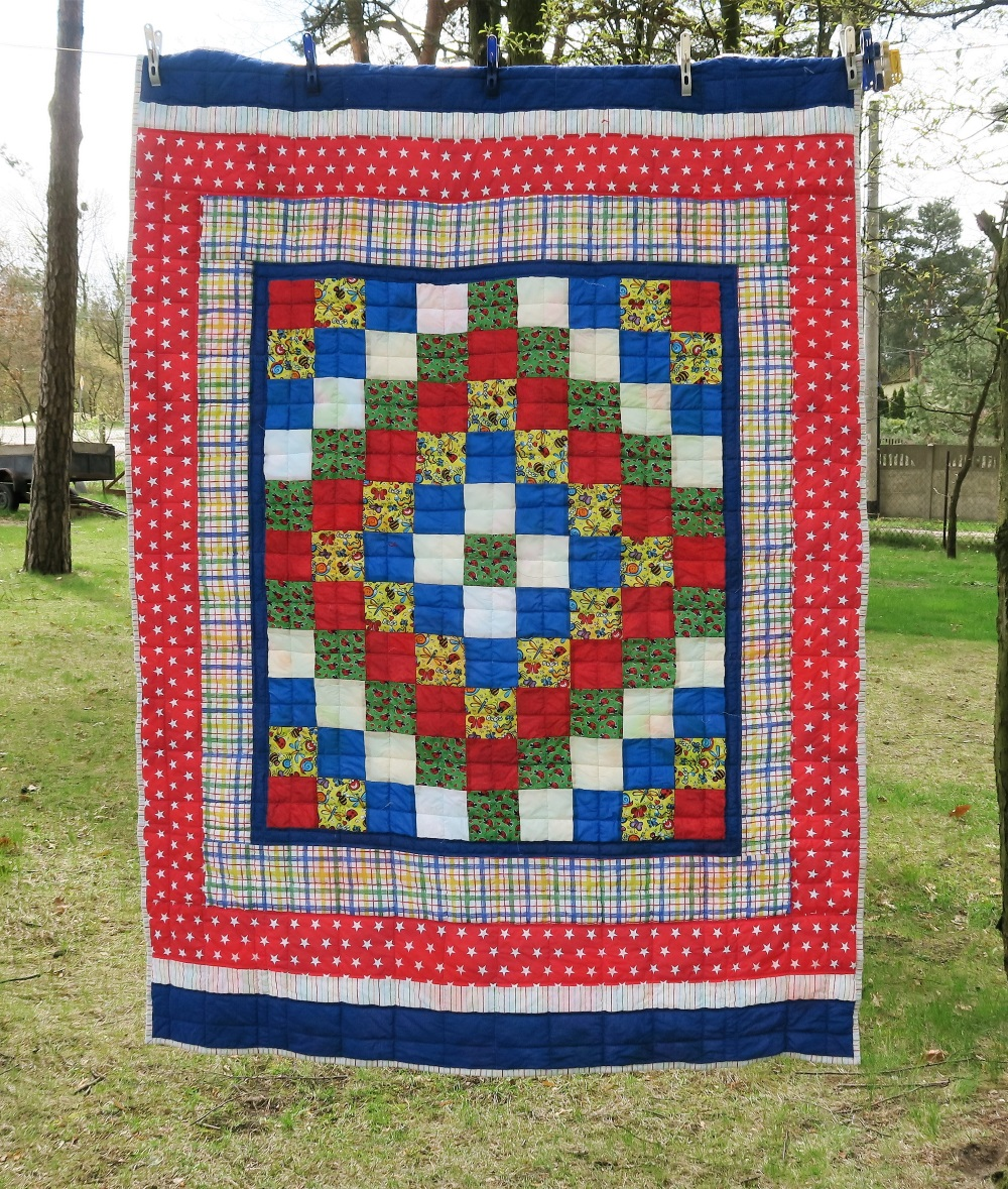 31 Center of top donated by a friend in AZ. I added borders to make it a European twin size.
