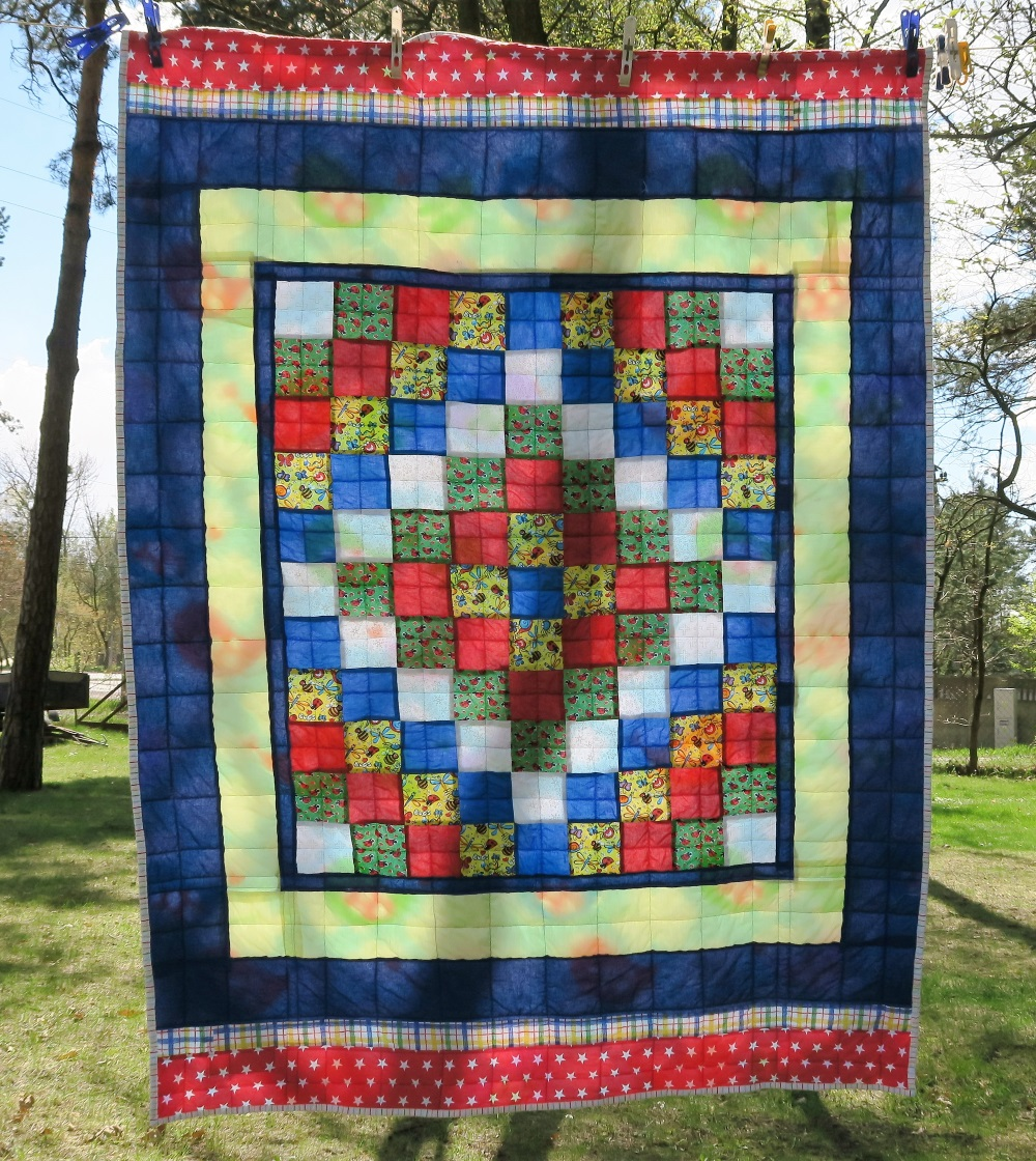 37 Center of top donated by a friend in AZ. I added borders to make it a European twin size.