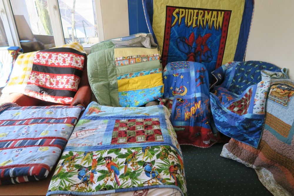 """I separated out what I thought of as """"boy"""" quilts - but I did have one mama make a beeline to the boy quilts for her daughter - as she wanted blues and not whites and pinks."""