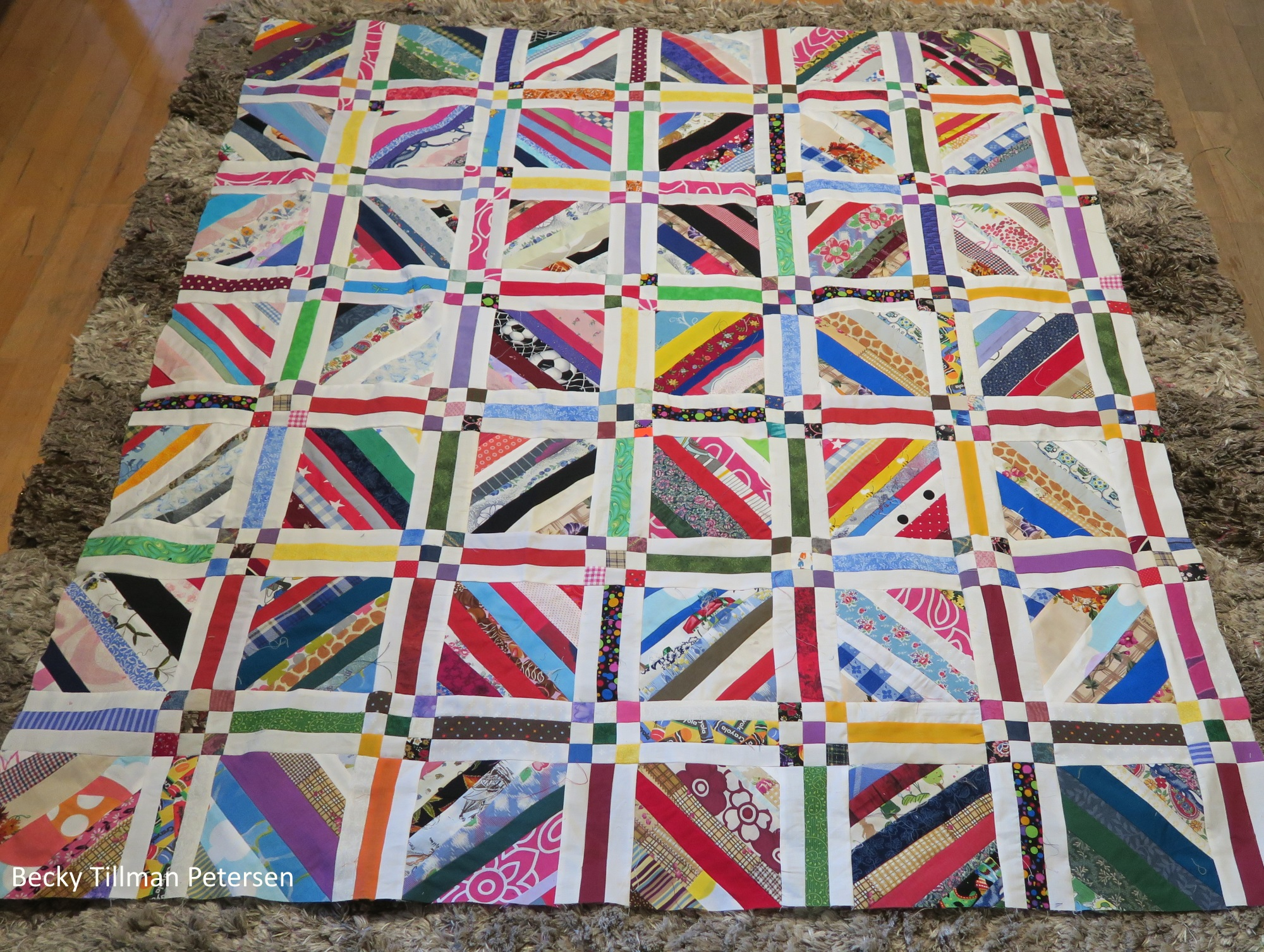 """It's currently 54""""x62"""" - getting to be a nice lap quilt size. Last week it felt like a baby quilt, so I'm making progress."""