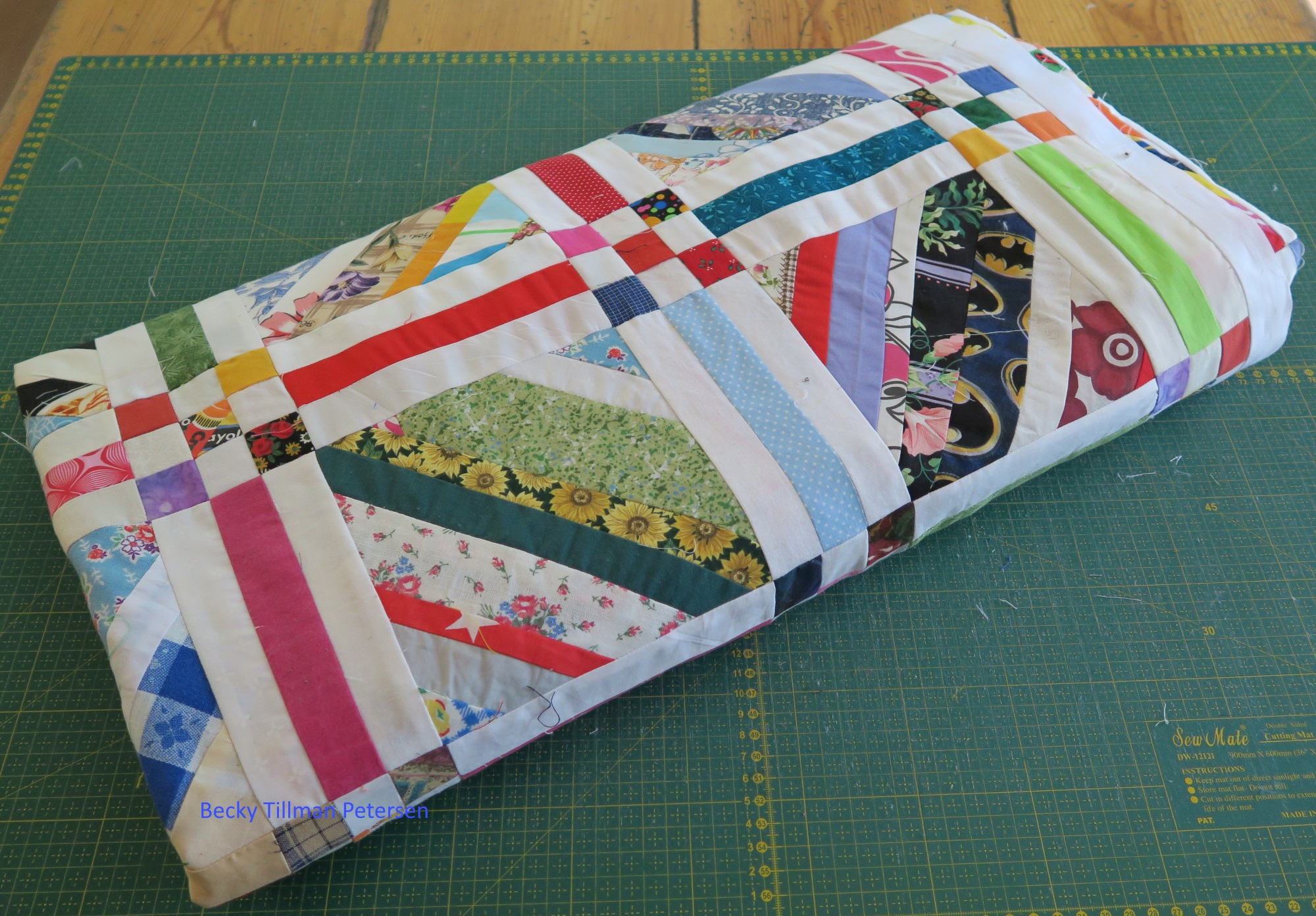 "It almost looks like a quilt roll here, but it's just a ""folded top"".."