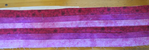 "First, make a piece of fabric form 1 1/2"" strips - in a variegated color scheme."