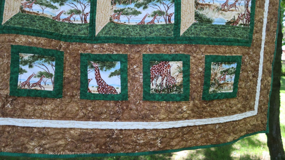 """I quilted with pebbles around the frame - because the fabric I used here was called """"Stonehenge"""" - it is wonderful fabric and I thought it appropriate if I made it pebbles and rocks."""