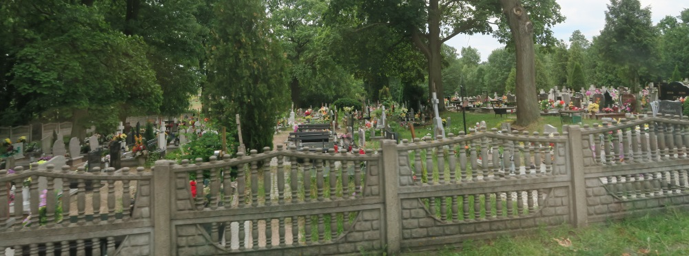 A typical Catholic cemetery. They are also almost all fenced in.
