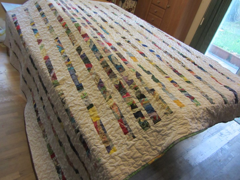With this one, I used narrow strips, but I spaced them wider as I went toward the edge of the quilt.