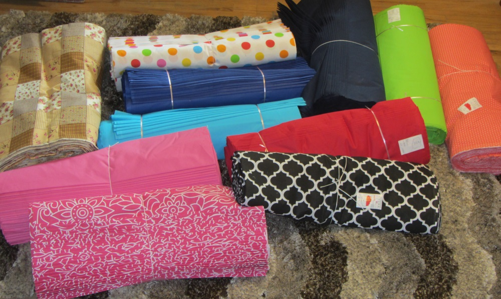 As you look at this picture, you can see some solids and some printed fabrics. As of this writing the printed fabrics are gone - almost all used as backings for charity quilts. I still have some of the solids. I bought this back in June, 2015.