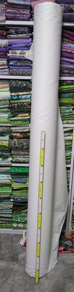 """The """"bolt"""" of white. Yep. That's a lot of fabric! That's a meter stick in front of the fabric. My husband made it for me for Christmas!"""