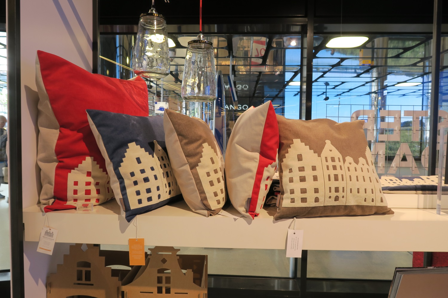 """Obviously I wasn't looking in the right spot, but these were about the only """"soft"""" items I saw. Pillows - that looked like Amsterdam. I looked at them closely and these pieces must have been glued on as there was no stitching around that applique part. The applique was some sort of a rubbery feeling type fabric - not a cotton, so probably not so easy to sew."""