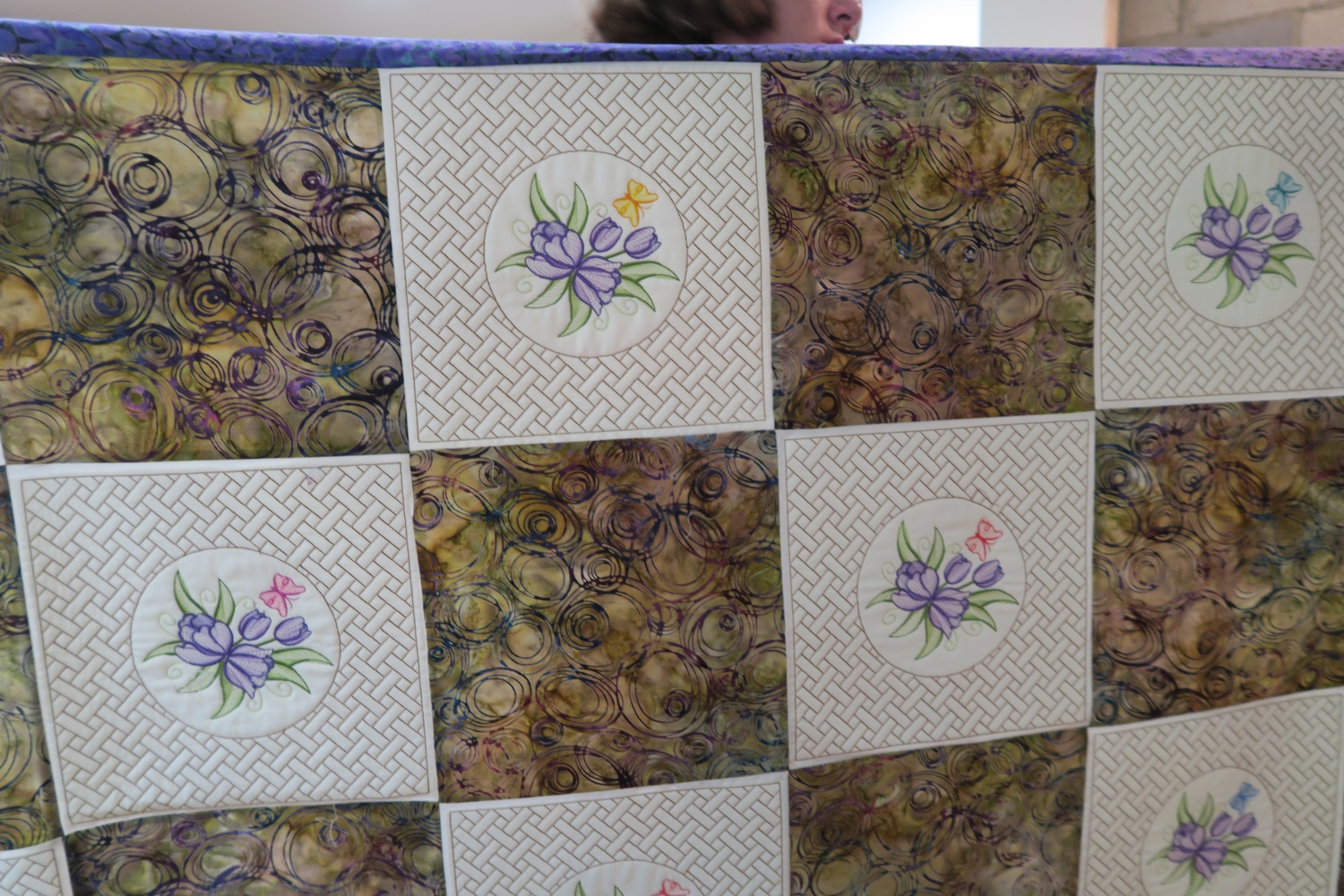 This is a quilt April is making for her mother. The embroidery is delightful!