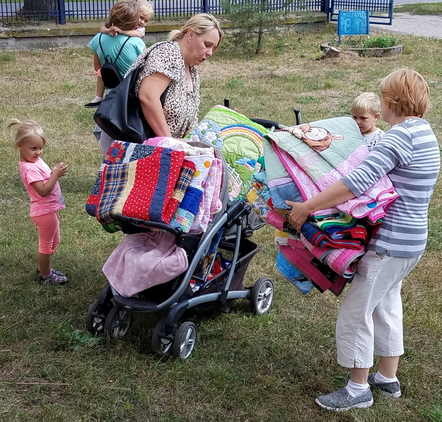 This lady was trying to get 9 quilts on this stroller. She has two sets of twins!