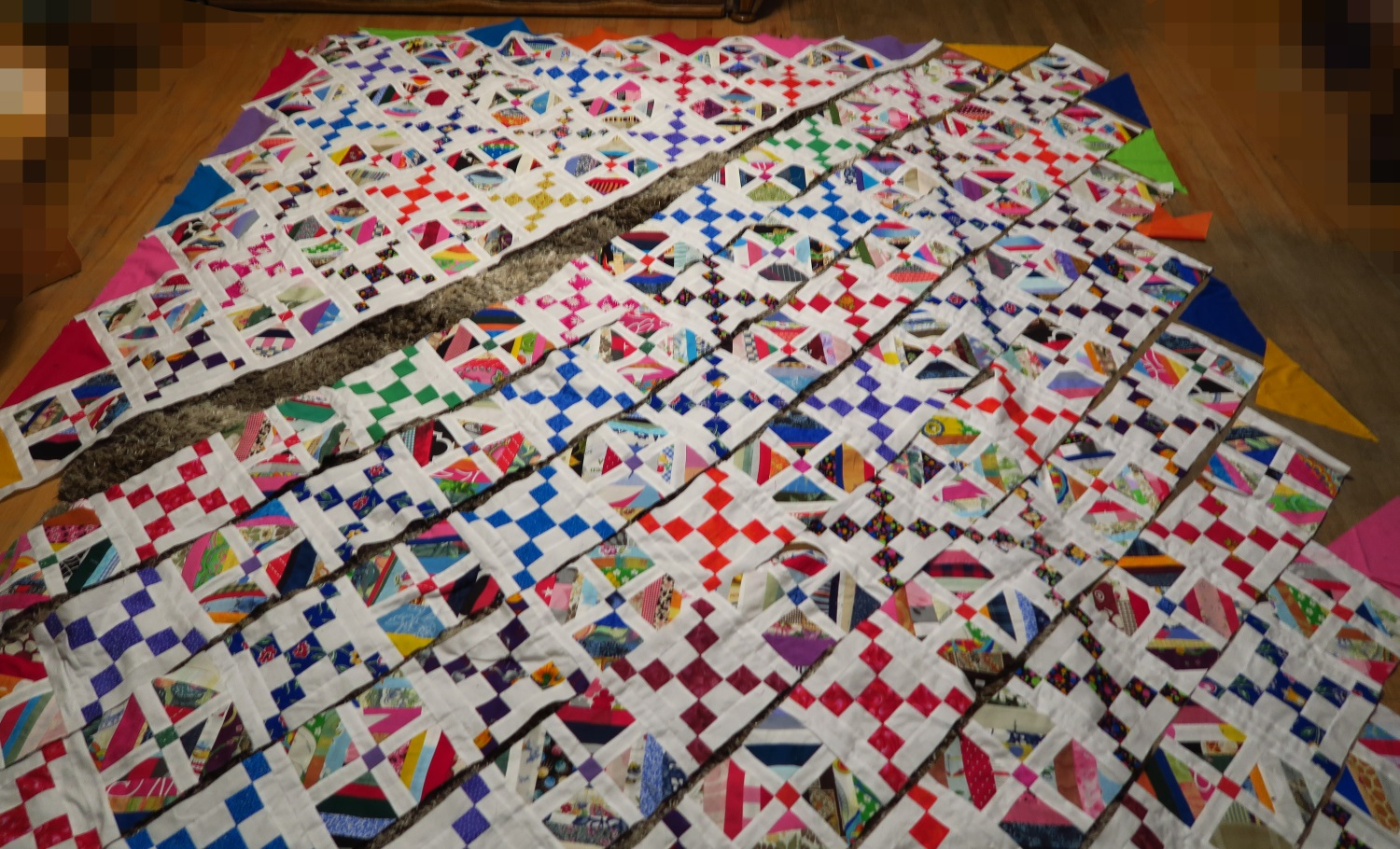 This is how it looked after I sewed the first 6 rows together. (These are diagonal rows as usual when making an on point quilt.)