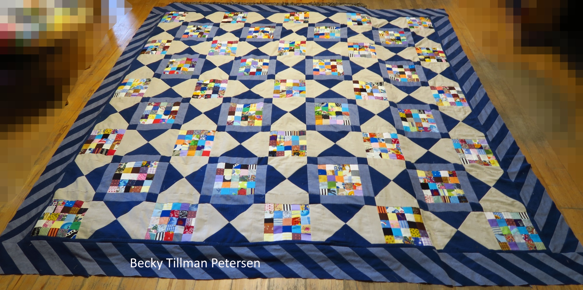 Picture of happy days quilt with square quilt pannels
