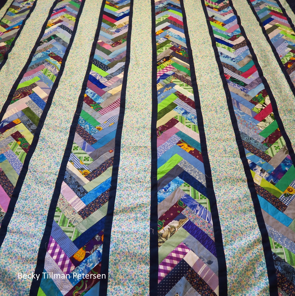 A view of the quilt farther down... overall bue and greans are the major colors of the quilt.