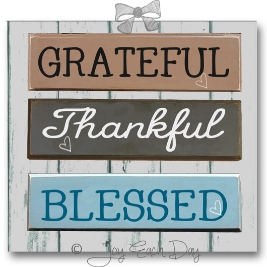 "a board with three words displayed ""Grateful"" ""Thankful"" and ""Blessed"" Copywrited to Joy Each Day. This indicates our attitude to you: ""we are greateful and thankful to have you come to us and have a blessed day!"""