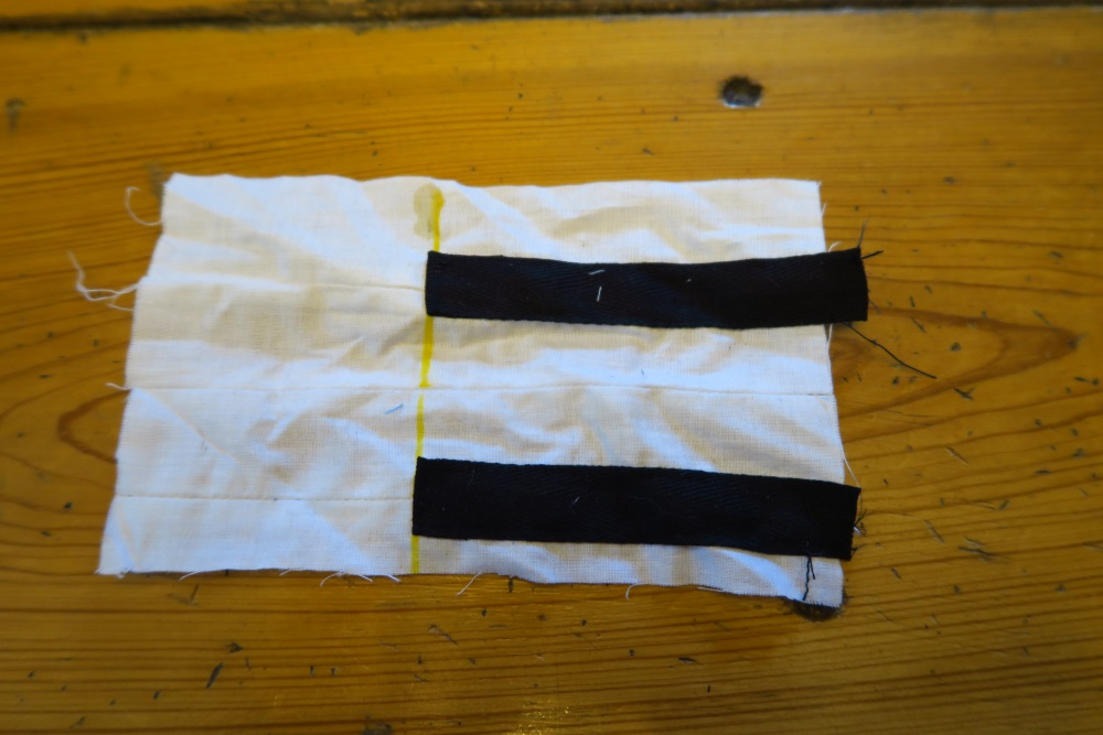 Fold the ends of the keys UNDER so there are no raw edges. Line the ends up with the yellow line you drew.