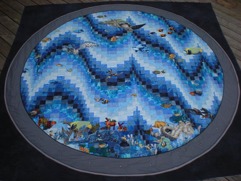 Colleen Froats made this beauty for her husband who requested a porthole quilt.  Isn't it great?