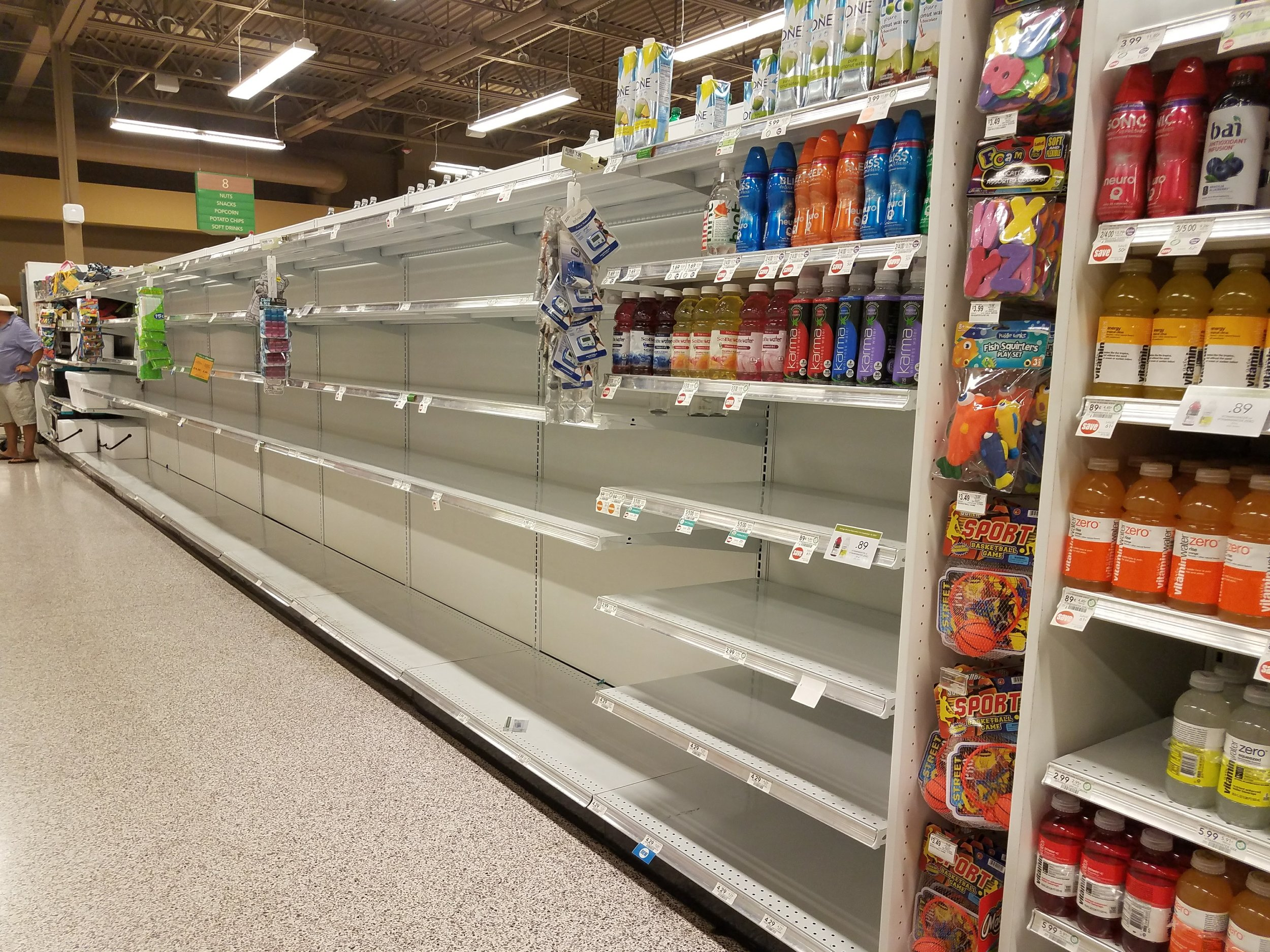 Shelves at Publix are cleared of water.