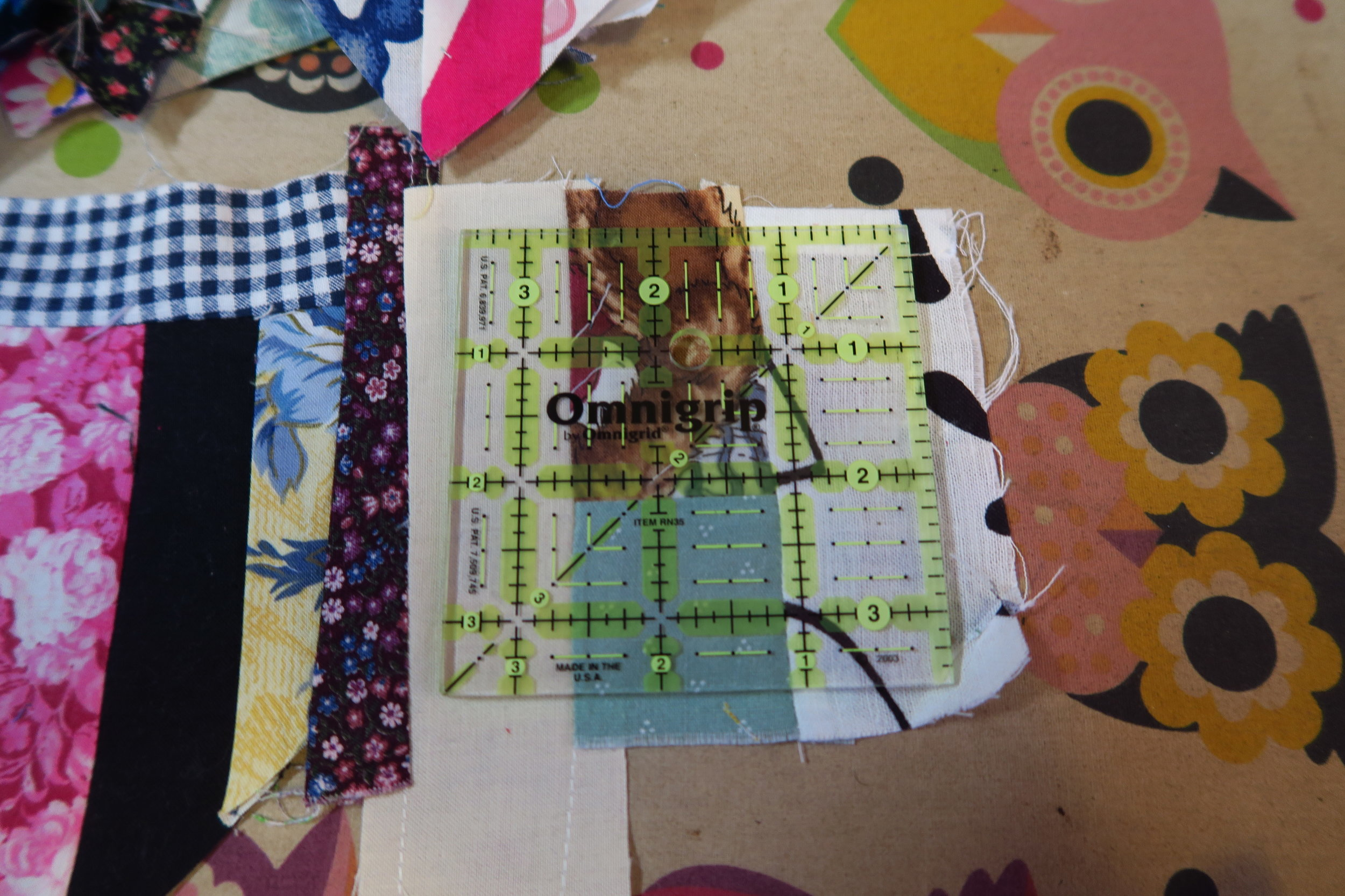 """Before declaring my 'made fabric' big enough, I checked to make sure (it it was questionable) to be sure that I could cut a 3.5"""" square from it using my ruler."""