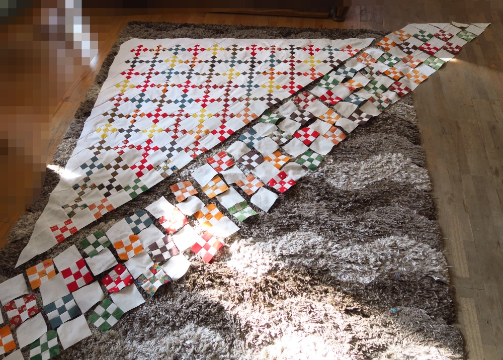 Sew a few row.s. Take more pictures and lay out some more rows.