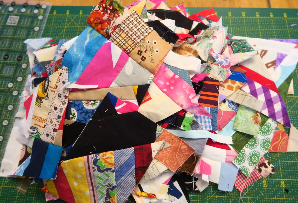 Add all those cutoffs to the pile for a rerun on more crumbs blocks.