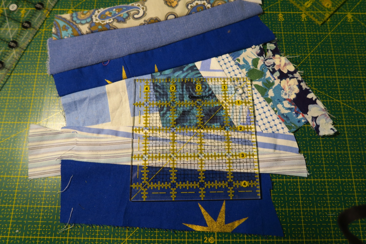 """The center crumb block under construction. I actually have a piece of """"made fabric"""" here and am just trying to decide where the most interesting cut should be.  I'll use whatever is leftover towards the next crumb block middle."""