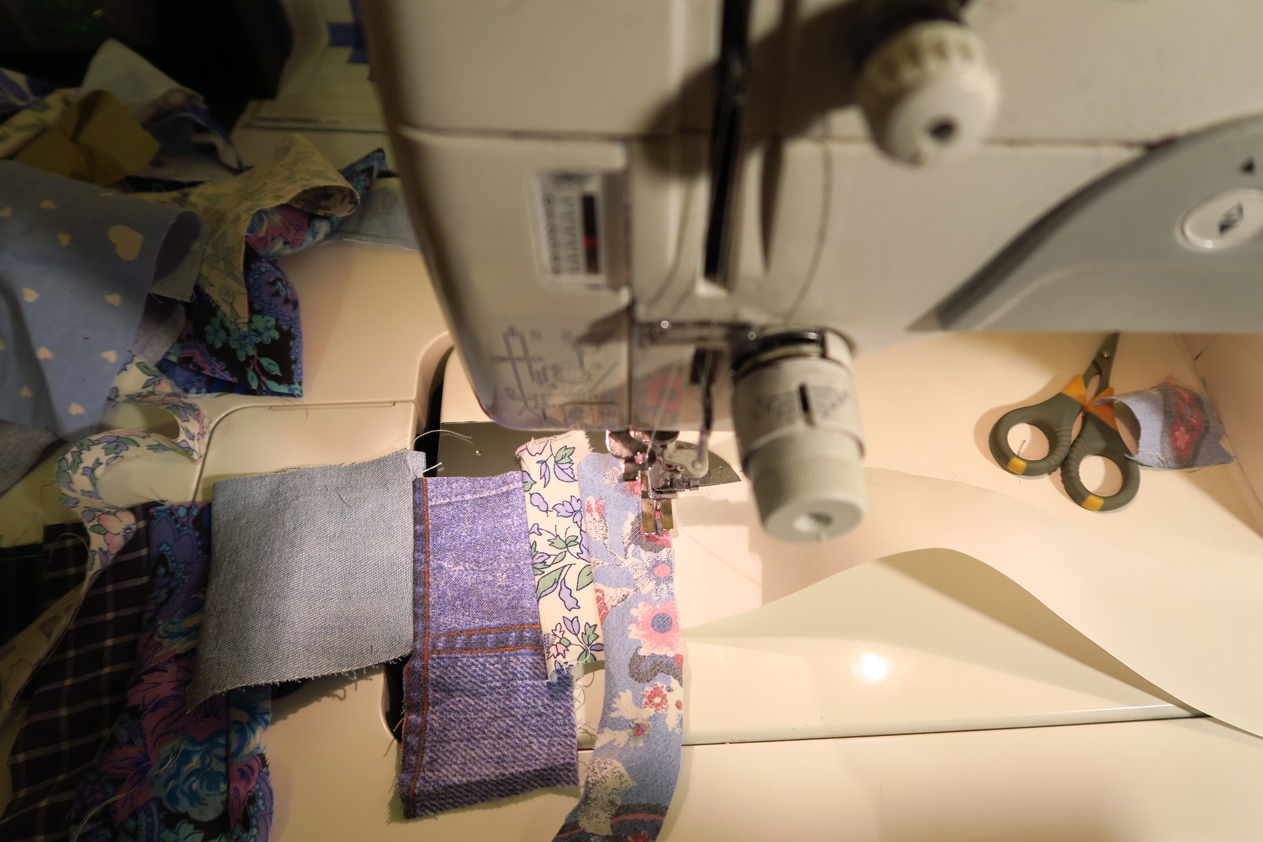 Sewing the scraps on to the tape.