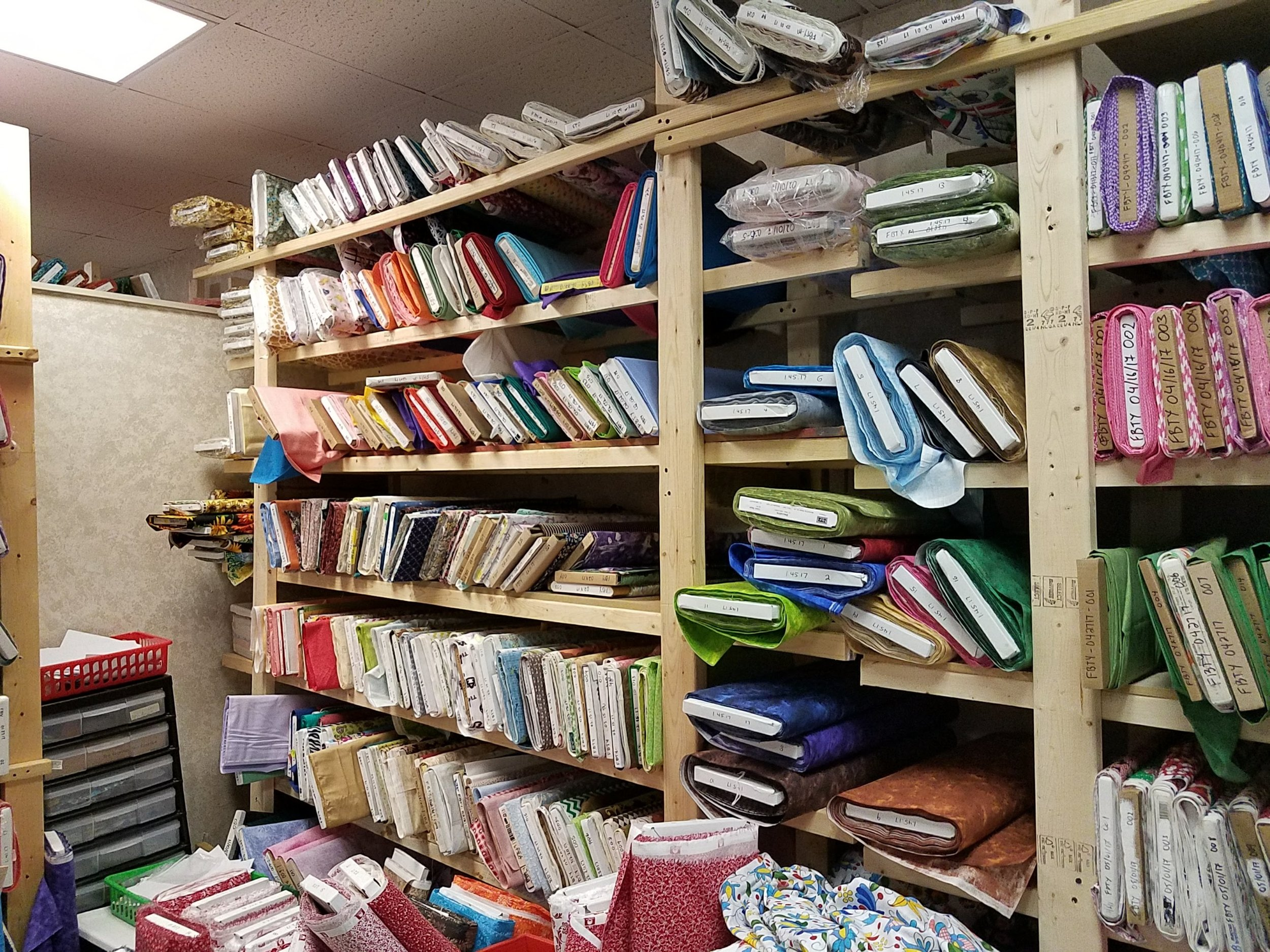 All but the impossible to reach units were filled to the gills. - When we weren't putting up fabric, we were cutting it up into half yard and fat quarter packs as fast we could, but found ourselves having to move tubs of fabric out of the way continuously, in order to be able to reach the shelves we needed.