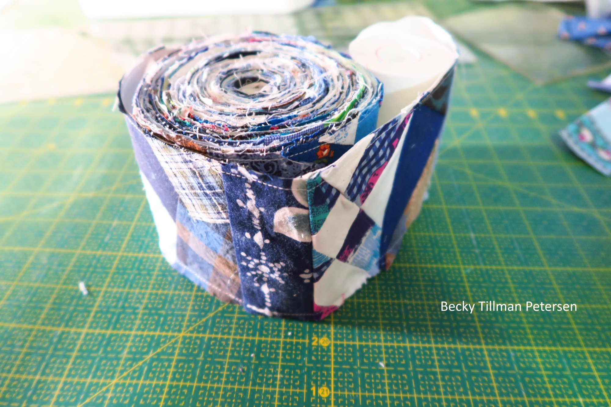 """I needed almost 400"""" of this and as of last week I had about 320"""". Rather than push and finish those last 80 inches last weekend, I decided to just let it go and finish the whole top this weekend. This is the total I needed to go around the quilt top - as border number 2."""