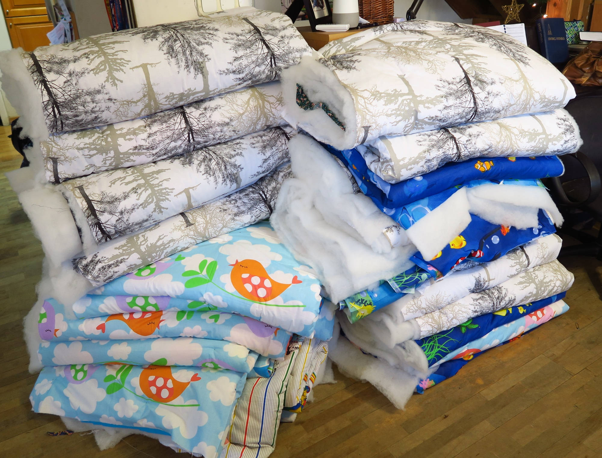 """I got a little tired of sandwiching """"little kids"""" quilts - so we advanced to some of the adult tops I have - darker colors and more mature designs - in other words, not children's prints!"""
