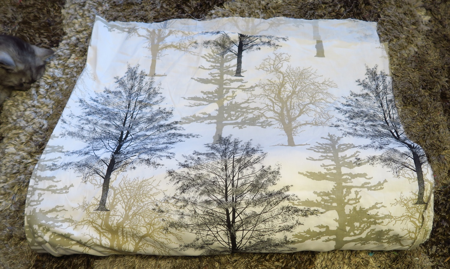 """This fabric has rather large trees on it but it makes a fine backing. The fabric is soft to the touch and I am sure at least some people will like it. We live in a part of Poland with a lot of these kinds of trees, so that adds to the fun of it. It's from a Polish manufacturing and is about 65"""" wide. I have decided to invest in these wide fabrics so I don't have to piece my backings anymore. It definitely makes it faster! And the Polish people like it because it makes a double sided quilt!"""