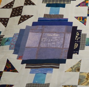 This blue fabric square is the same fabric that I used for the lighter chain in this quilt. It was a duvet cover so I had quite a bit of fabric in it.