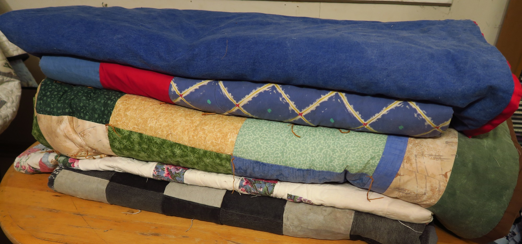 This is the same pile of quilts as on the left - just stacked neatly.