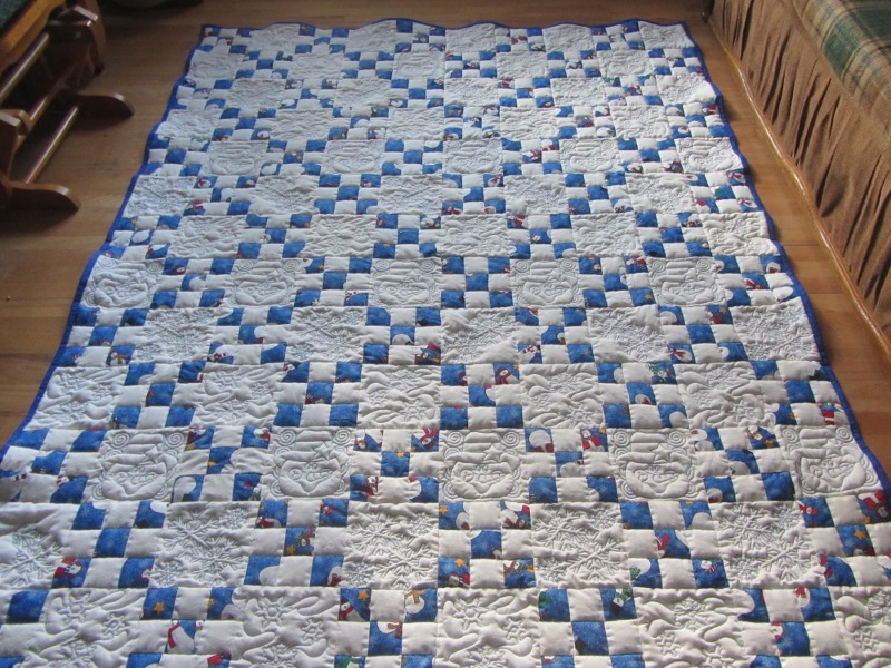 A traditional Single Irish Chain with alternate embroidered blocks. It took forever, but I love the look!