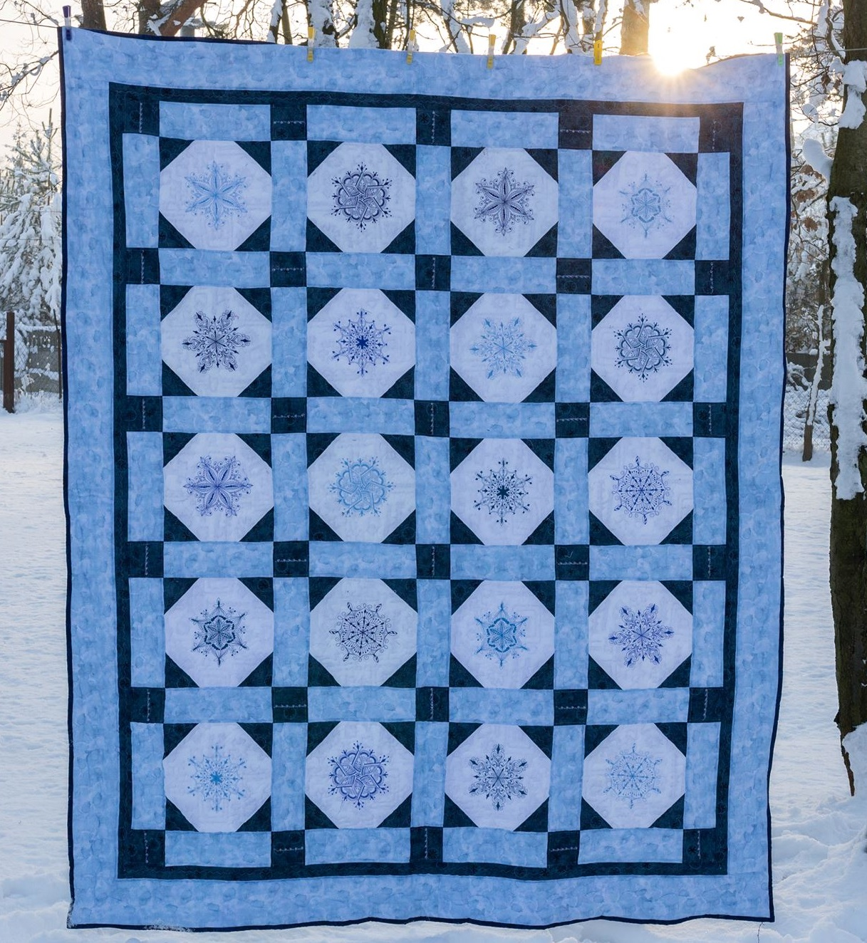 This one was made of embroidered blocks. I used a snowballed block as the setting. :)