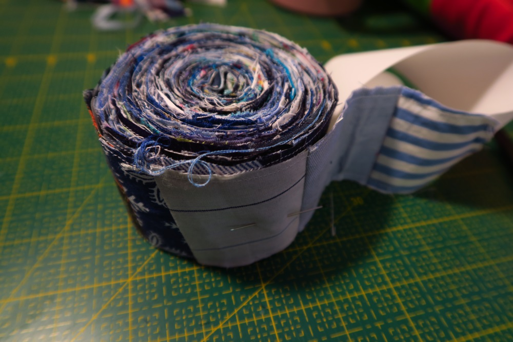 My roll looks like this. I can do this kind of sewing when I'm pretty tired as it doesn't involve anything technical or really any decisions about anything. Just put a piece on and go on. No worries about color, half square triangles, measuring, or anything.