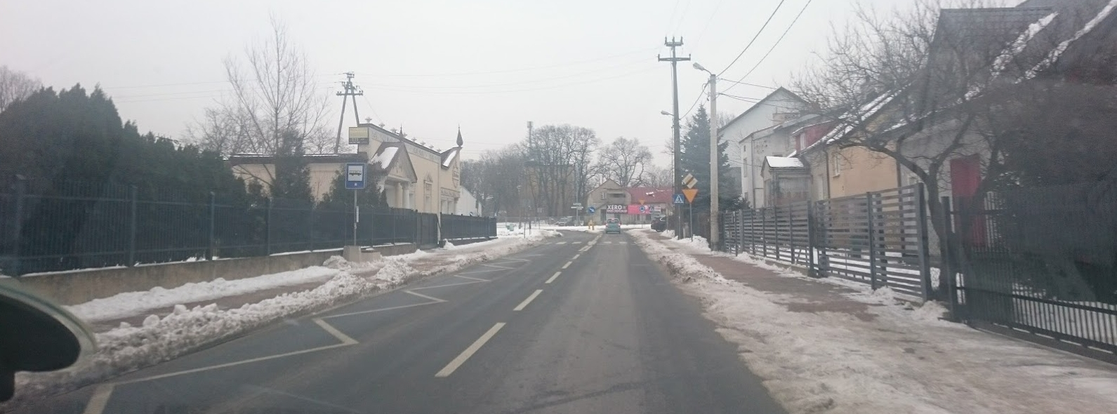 """On the right side of the picture, in the sidewalk area, you can see where it hasn't been shoveled. At this time, that would be treacherous to walk on . It has since rained and every place like this is extremely slippery. The bone hospitals are probably full with people who have fallen. Lots of people here do not have cars and """"still"""" walk from point A to point B."""