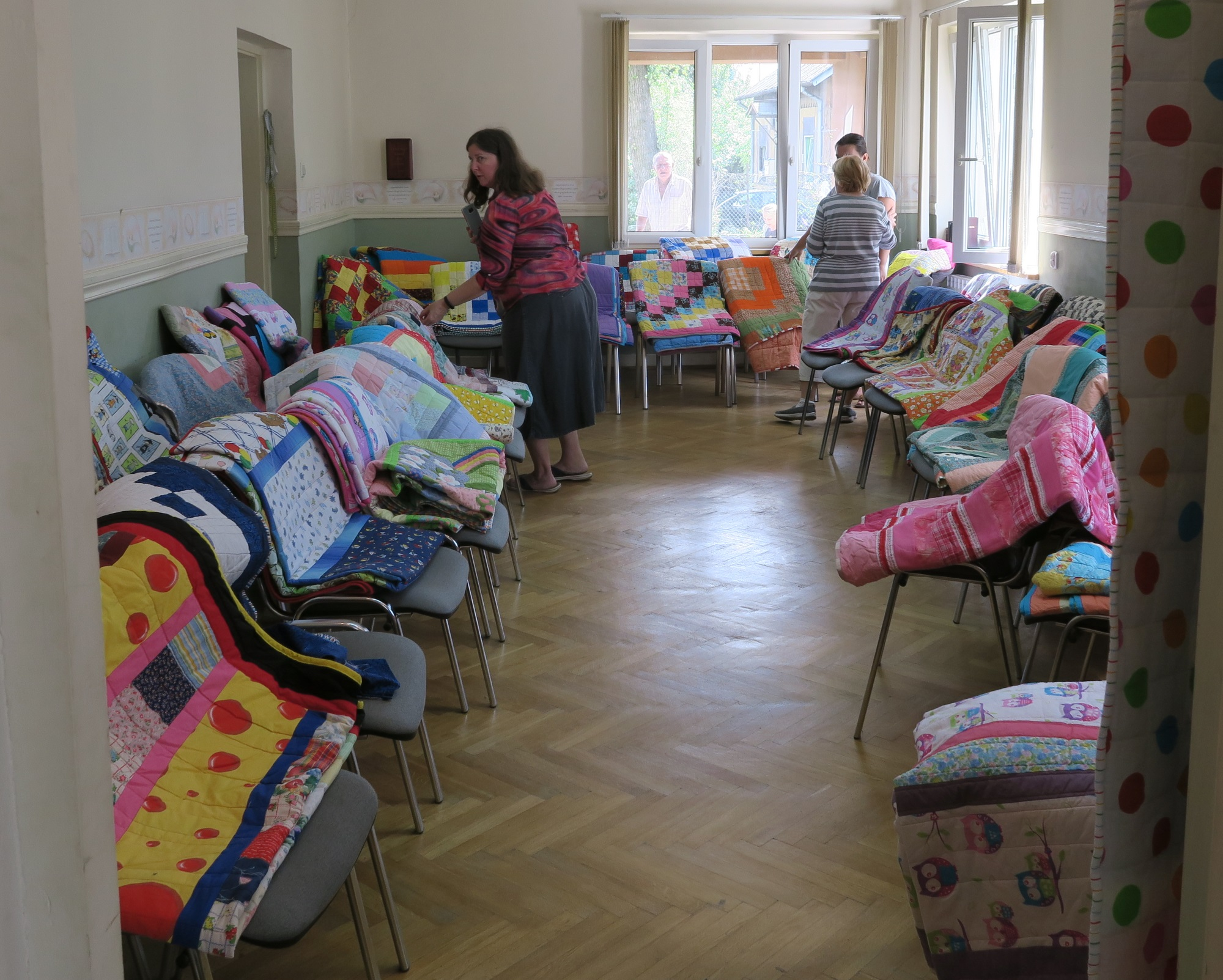 This picture was taken last August when we had a big give away of charity quilts to people from Otwock, Poland.