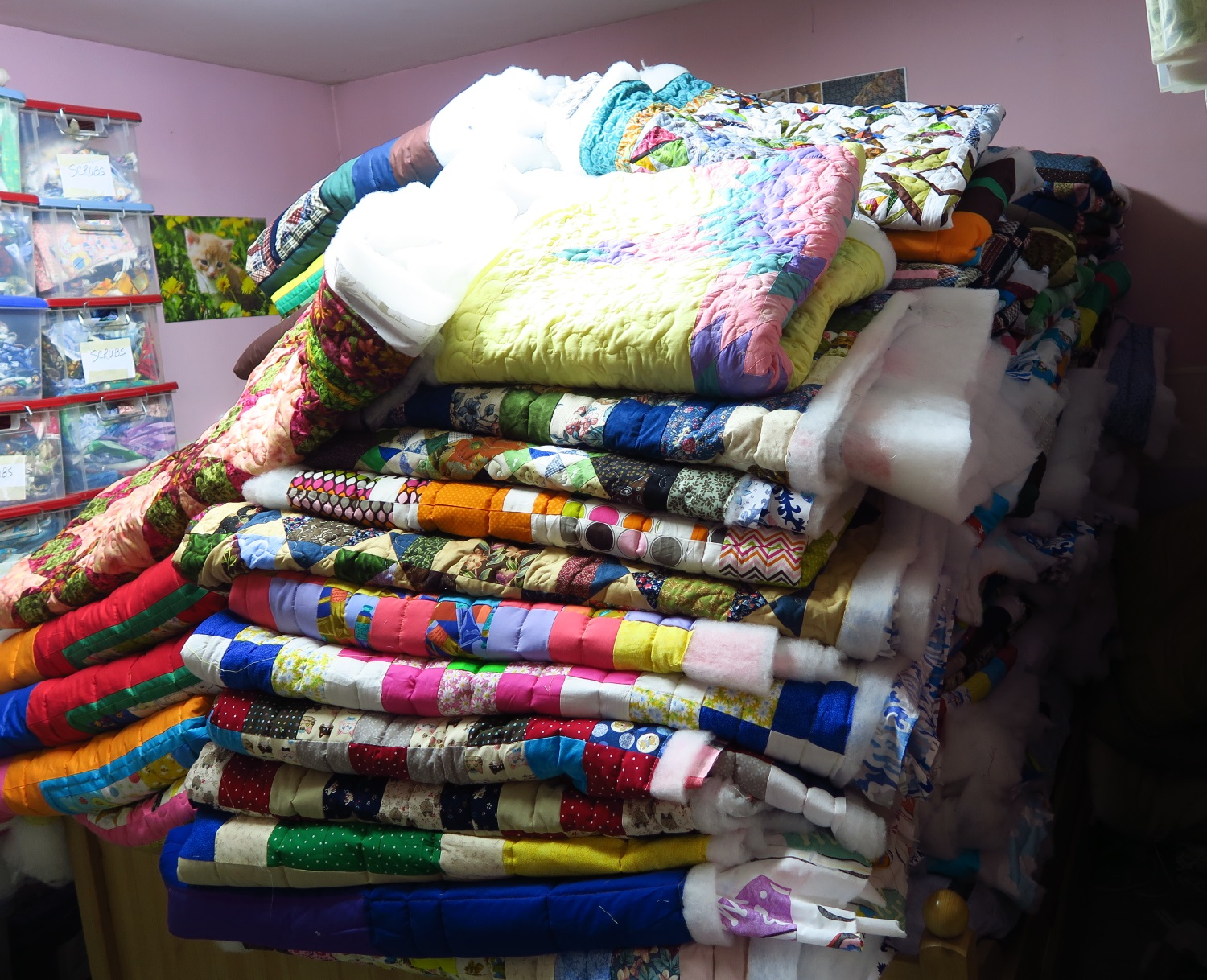 This is a picture of 120 charity quilts untrimmed and unbound.