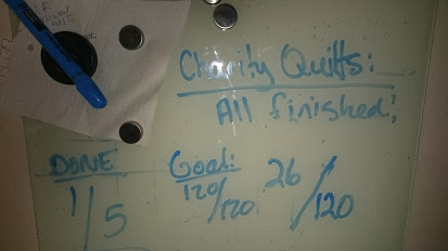As I get a couple of quilts completely bound, I take them downstairs closer to the washing machine and change the numbers on this board. I need the constant feedback in order to keep myself encouraged.