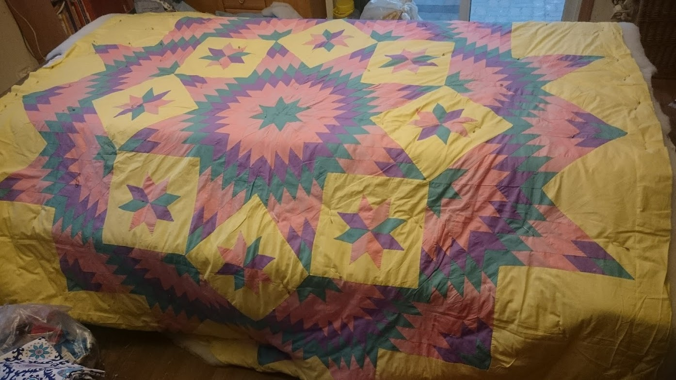 Sandwiching this beauty! Can you believe someone donated this hand done quilt top? It is truly an amazing quilt!