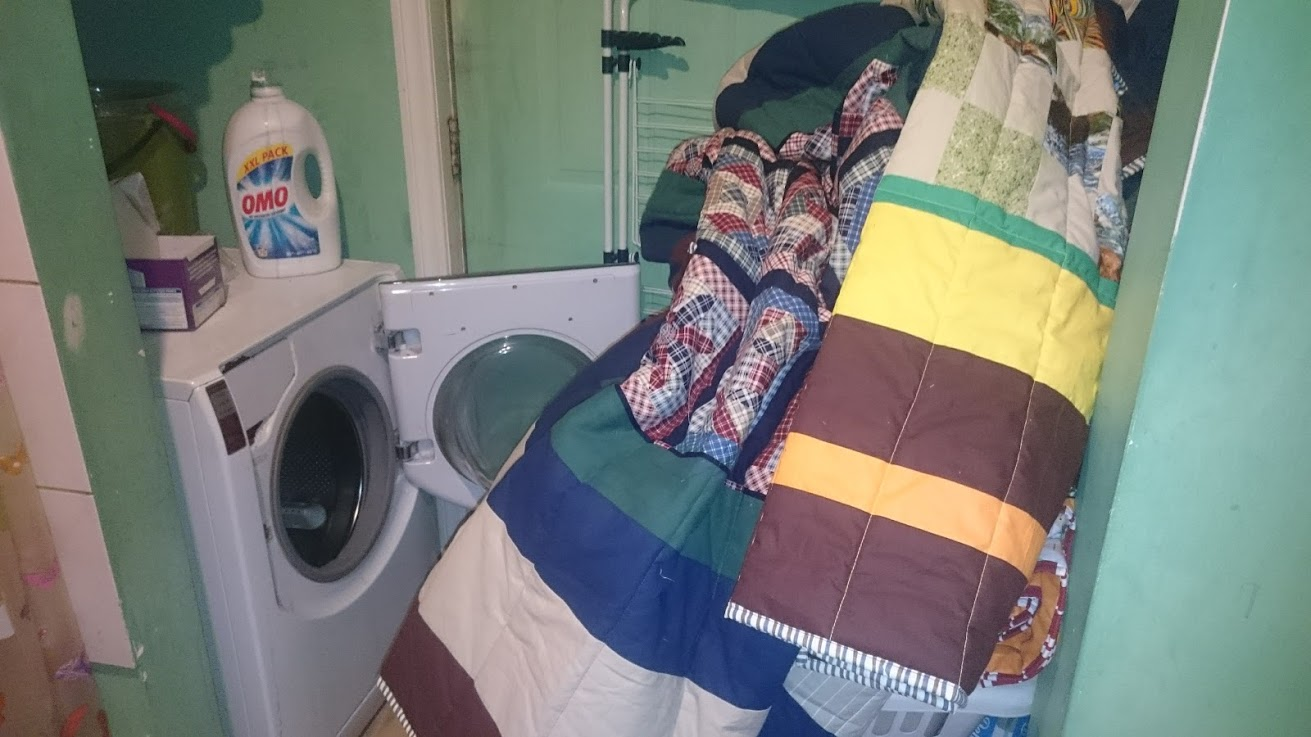 My washing machine, while large for a European model, really only holds one quilt at a time. The quickest load takes 1 hour 35 min. So far I've washed 60 quilts.
