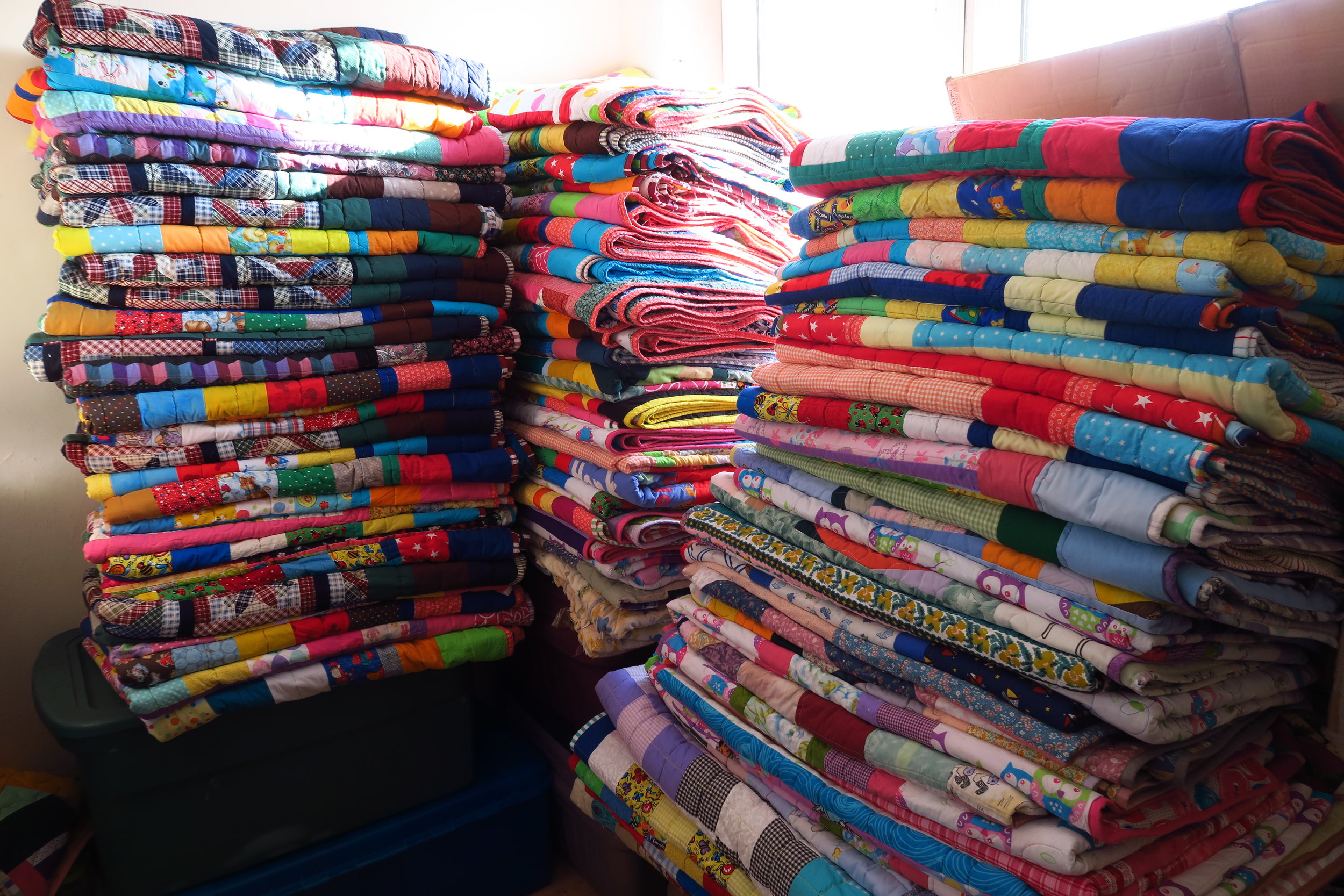 This is with these quilts added to my piles.  It is fun to see these grow higher and higher!  I think it looks neat!
