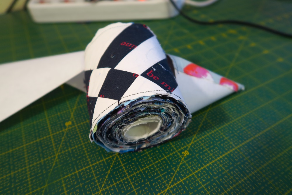 """This is about 100"""" of scraps sewn onto this 4"""" wide adding machine tape"""