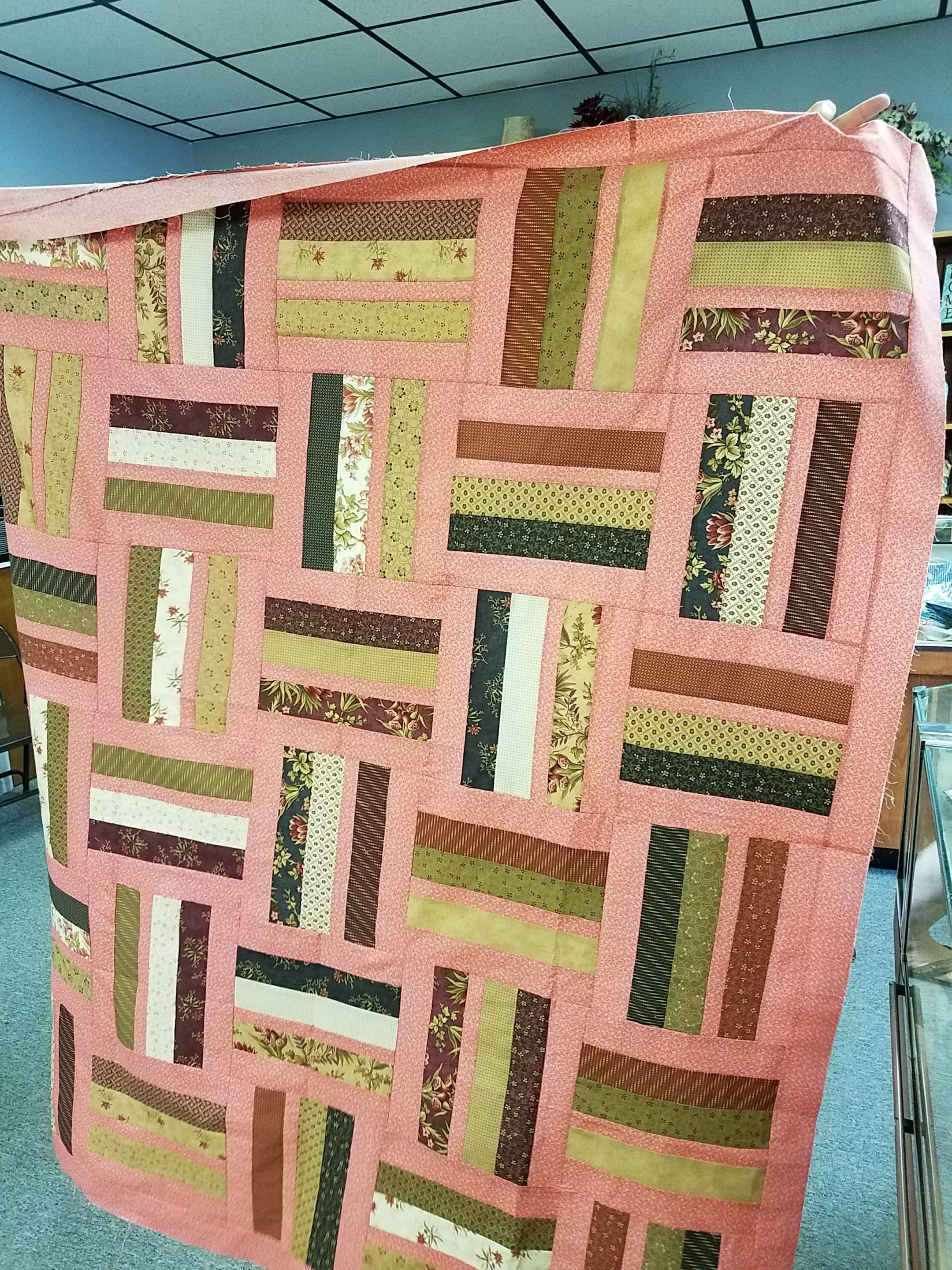 Helen used 100% QuiltedTwins.com fabrics! - I was thrilled to see someone using this color combination.Helen brought in her own pattern, but it looks very similar to Becky's Pastel Rails..