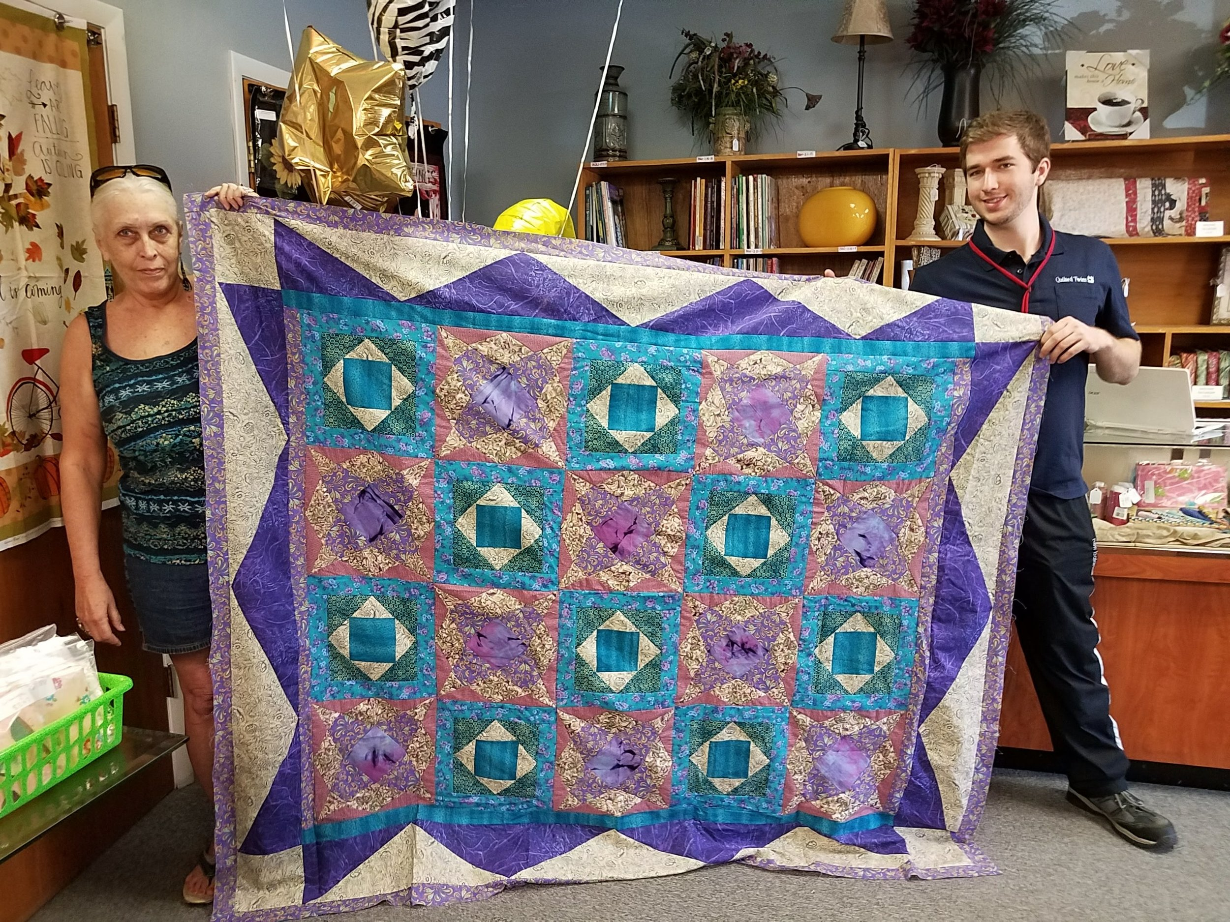On 5.10.18 Helen Newcombe (below) brought in a beautifully blue quilt top she had made. Our fabric is the turquoise blender fabric. It's for sale  here: