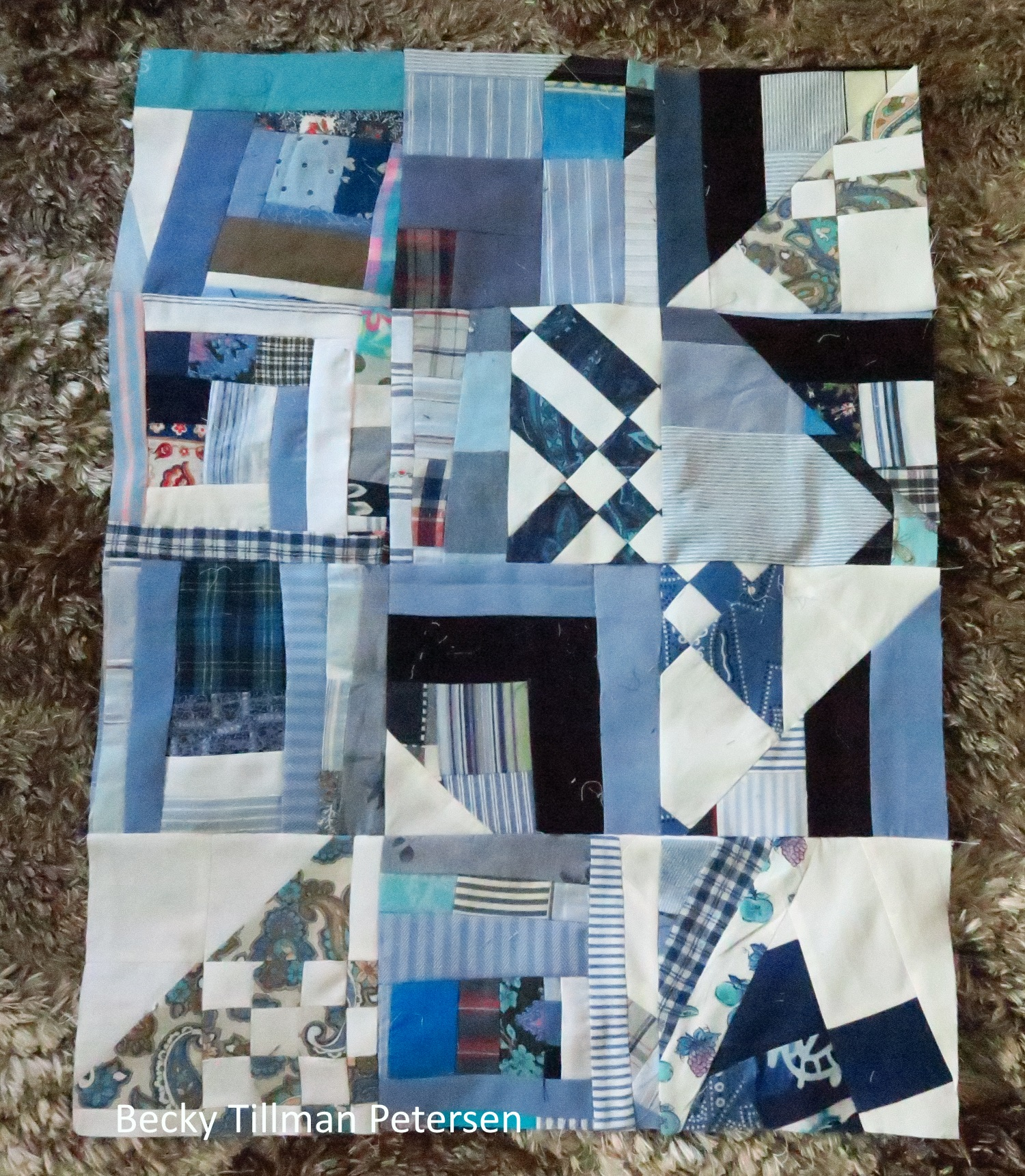 """So far it is 18""""x24"""". I'll try to add to it weekly until it is the size I want. This is going to be like a """"free quilt"""" as I am so ready to toss these pieces into the fireplace! I think this top will also be a heavy one. We'll see."""