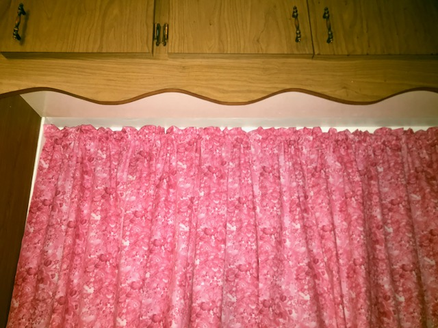 Maggie came into the store and had us cut her fabric to the right size and went home and got her new kitchen curtains up right away! - Way to go, Maggie. This fabric is pink faded flowers.